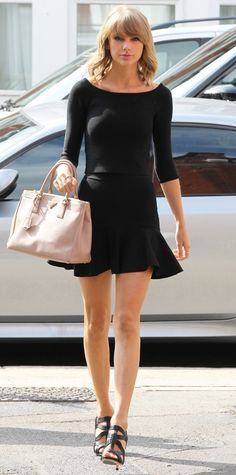 Taylor Swift showed off her long legs in London in a flared black minidress, finishing the look with strappy sandals and a blush handbag. #InStyle