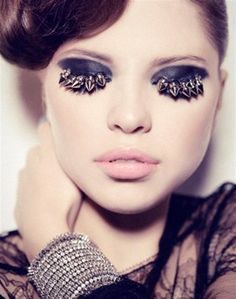 As a makeup artist I have tried to glue things to my eyes- feathers- glitter but heavy metal spikes why?