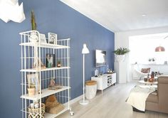 A Dutch Home with Pretty Paint and Clean Lines A Helmond-city house in Holland proves that brilliant wallpaper and paint are all you really need to craft an impactful abode.