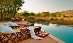 The tents at Sher Bagh, Rathambore, are furnished with Edwardian furniture. Sun beds, hammocks, armchairs, and mud-decks scattered around the camp create quiet, shaded places to unwind and admire the wild setting. Photo courtesy Sher Bagh