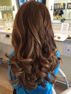 The back of a Cosmo Tai at #DryBar with its thickness, volume, and curls!