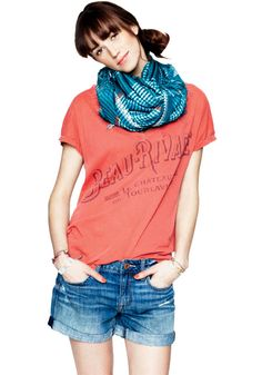 A bundled scarf in a contrasting color gives a T-shirt style cred—and keeps your neck cozy