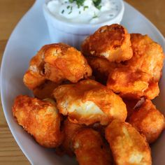 "Crispy Cauliflower Bites Make Even Better Buffalo ""Wings"": Any self-proclaimed cauliflower hater will be forced to change their tune after tasting this creative recipe."