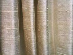 raw silk curtains in cream with large white panels at bottom ...