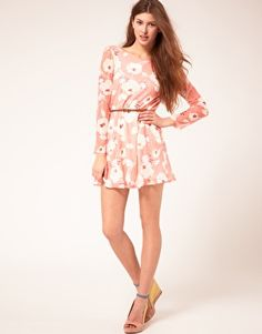 Love the mix of long sleeves with short skirts.