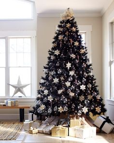 Black Christmas tree with silver and gold decorations