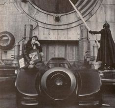 Art designer Anton Furst posing with his two creations, the Batmobile and his expressionistic design for Gotham City. Tim Burton Batman, Jim Lee Batman, Jason Todd Batman, Batman Robin, Batman Arkham City, Batman Arkham Origins, Batman Poster, Batman Comic Art, Gotham City Map