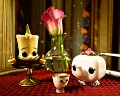 "Funko Pop!'s from Disney's ""Beauty and the Beast"". The setting is a room service tray in the Boston Harbor Hotel (which is a great hotel btw)."