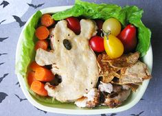 To make your own at home, simply cut your tortilla with a ghost-shaped cookie cutter, fill it with healthy goodies and cook it up as usual. Super easy! This spooky-delicious lunch also includes baby carrots, cherry tomatoes, cucumbers, and no-waste baked tortilla chips that were made from the leftover tortilla scraps. We love the idea of turning those scraps into a bonus lunch treat!