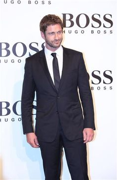 """No. 15: Gerard ButlerThe """"300"""" star looked sharp in a classic black suit at the Hugo Boss fashion show in Shanghai on May 30, 2013.RELATED: Hunks of summer"""