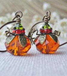 These adorable earrings are made with orange crystal rondelle beads measuring 11 mm (7/16) The pumpkins are adorned with an antique brass bead cap, Swarovski crystals and brass wire. They are suspended from natural antique brass, nickel free ear wire. The earrings dangle at 1 1/2 long.  Your order will arrive beautifully packaged, perfect for gift giving.  If you have any question, please do not hesitate to contact me Thanks so much for stopping by! Kay :)
