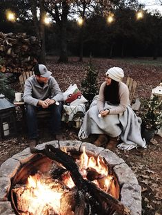 Check out our DIY fire pit area and outdoor space on a budget. Adirondack chairs, string lights, wood holder and more DIY ideas. Fire Pit Party, Diy Fire Pit, Fire Pit Backyard, Outdoor Garden Rooms, Outdoor Spaces, Outdoor Living, Outdoor Decor, Outdoor Patios, Outdoor Kitchens