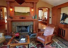 This is why I love craftsman bungalows. Look at that wood work, the arched doorways, the fireplace. beautiful.