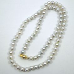 24 Inch Strand of 7 mm Grey Pearls. $1,000