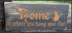 MoonlightPrimitives is a genius.  I have this one with orange background and black letters on the mantel with season of the witch. Home Is Where You Hang Your Hat, Black Cats, Witch, Wicca, Rustic, Primitive, Wooden Signs