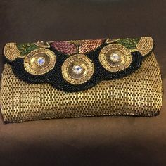 Beautiful beaded clutch Beautiful beaded clutch with gold/blue/green/red/black/and rhinestone detail. Great for any occasion.  5 inches x 9 inches. Excellent size! Bags Clutches & Wristlets