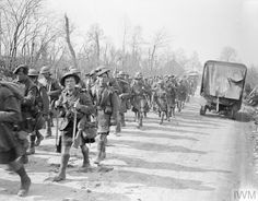 WWI, 23 March 1918; Troops of the South African Scottish Regiment or the Moislains-Bouchavesnes road, Battle of St. Quentin. © IWM (Q 8594)