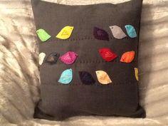 Handmade cushions with felt birds on a wire!