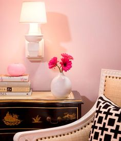 Pink & black foyer with pink walls paint color, chinoiserie black & gold chest, Oly Studio Hanna Chair and black & white geometric pillow.