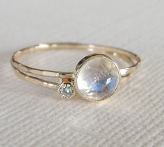 A personal favorite from my Etsy shop https://www.etsy.com/ca/listing/238157960/rainbow-moonstone-ring-set-moissanite