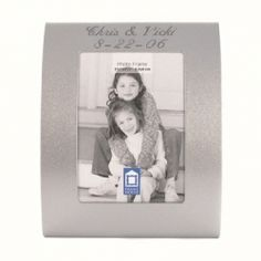 Engraved Curved Silver Place Card Frame - Create A Favor http://www.createafavor.com/p-C2X3CRV.html