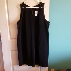 Lane Bryant size 24 black dress Lane Bryant size 24 black dress with cutouts on the straps (see pic) and gold zipper down back. New with tags. Lane Bryant Dresses