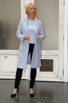 Baby blue outfit. Black trousers, blue sweater, blue coat all by Vanillia. Blue suede pumps by Peter Kaiser.