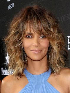Halle Berry Medium Curls with Bangs - Halle Berry rocked voluminous curls with eye-grazing bangs at the Black Women of Bond Tribute.