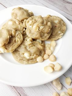 Macadamia nut white chocolate chip cookies, made with a rich, buttery cookie dough base and studded with chopped macadamia nuts and white chocolate chips.