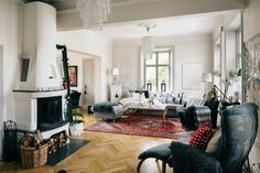 Mismatched furniture and a vintage rug are not strictly Scandinavian but the space is still quite cozy.