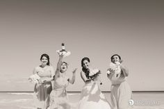 Bride and her bridesmaids playing with their bouquets from #Cancún at #BeachPalace @prweddings #DreamArtPhotography #DreamArtWeddings #WeddingPhotography #Wedding #DestinationWeddings #Photography #Cancun #CancunPhotography #Mexico #Bride #Bridesmaids #Bouquet #WeddingGown #Light #BlackAndWhite #BW
