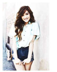 Chachi Gonzales blouse and high-waisted shorts.