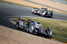 British Oliver Jarvis drives ahead of British Allan Mcnish during the 80th edition of Le Mans 24 hours endurance race