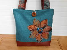 Brand new listing - Warm and Fresh colors of Teal Blue Turquoise and Rusty Orange blending together perfectly on this Handmade, On of Kind Tote Bag. A bit of shimmer in the Fabric flower petals and on the Shoulder strap handle Fabric, takes this Tote from a Work Bag to an out for