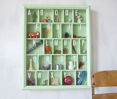 We're always on the lookout for new ways to display the alphabet in a child's room. Using an old picture frame and some wood, you can construct a shadow box, stencil letters onto the glass, and fill it with tiny, found objects to represent each letter. Click through for the complete how to.