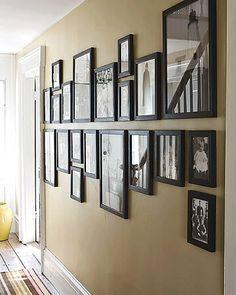 Family Photo Wall Display: Photo Wall Display Ideas Looks like the frames are either hanging or sitting on a shelf Family Pictures On Wall, Framed Pictures, Hallway Pictures, Family Wall, Arrange Pictures, Family Room, Hanging Family Photos, Family Trees, Ideas For Family Photos