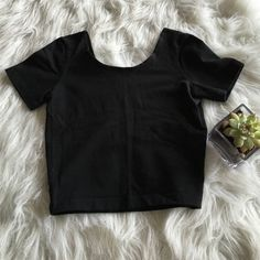 Black AA Crop Tee So so cute & only worn a couple of times! Perfect condition & perfect staple piece! Super stretchy. Make an offer or bundle for 20% off! American Apparel Tops Crop Tops