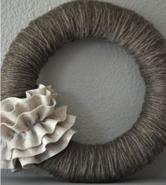 I've seen cute yarn wreaths, but I love the simplicity and adorableness of this one!
