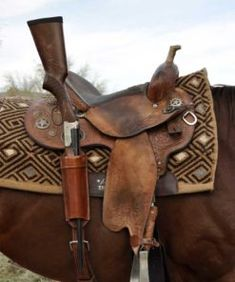 Designed to fit both lever action rifle, carbine or shotgun, this Long Gun Scabbard mounts directly to the rear rigging dee of western saddle, and is all one piece for easy installation or…More Gun Holster, Leather Holster, 1911 Holster, Western Horse Tack, Western Saddles, Cowboy Gear, Horse Gear, Horse Tips, Horse Accessories