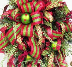 Fun With Ribbons, Deco Mesh & Ribbon Christmas Door Wreath, Holiday Wreath, Traditional Red and Green. $249.97, via Etsy.