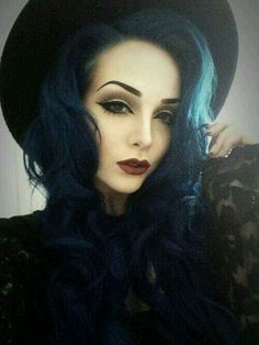 I want this elegant blackened teal blue hair. love the makeup too