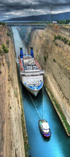 www.lyfeclub.com Check out this #amazing #photo The Corinth Canal connects the Gulf of Corinth with the Saronic Gulf in the Aegean Sea. The builders dug the canal through the Isthmus at sea level; no locks are employed. It is 6.4 kilometres (4.0 mi) in length and only 21.4 metres (70 ft) wide at its base & the rock walls rise 90 metres (300 ft) above sea level! #water #ocean #canal