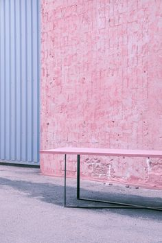 Pink concrete table top on iron table base. Design by Storm&Müller