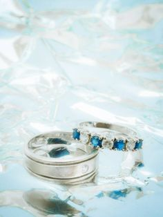 close up white diamond and blue gemstones on wedding rings with and
