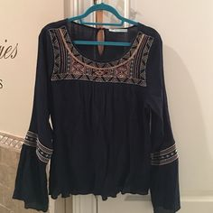 Navy Peasant top Navy Peasant Top with embroidery  and bell sleeves. Worn twice. Maurices Tops Blouses