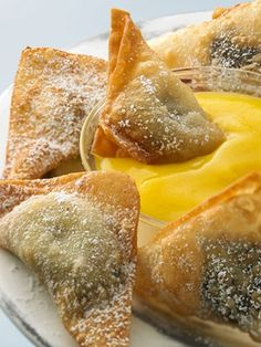 Hot Chocolate Banana Wontons - These sugar-coated fried appetizers are served with a refreshing mango-pineapple sauce