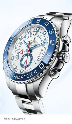 Rolex Yacht-Master II 44 mm in 904L steel with a rotatable Ring Command bezel, blue ceramic Cerachrom bezel insert, white dial and Oyster bracelet. #RolexOfficial