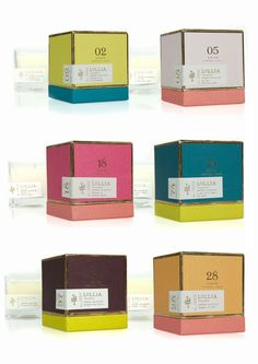 """Lollia PoeticCandles  Lovely packaging and use of color for Lollia's new line of Poetic License candles, given equally lovely names like """"Stacks of Pretty Paper"""" and """"Running in Grass Barefoot."""""""