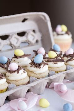 White Chocolate Egg Nests: Cream cheese, white chocolate, and butter combine to make the delicious frosting on these charming and festive cupcakes.