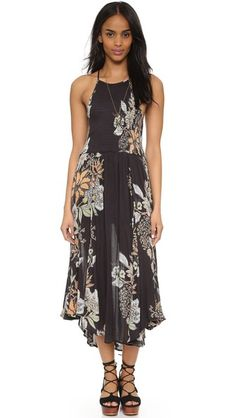 A swingy Free People floral dress with a smocked elastic bodice - get even more style and shopping inspiration on http://jojotastic.com/shop-my-favorites/